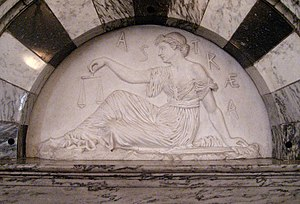 Dike (mythology) - An 1886 bas-relief figure of Dike Astraea in the Old Supreme Court Chamber at the Vermont State House