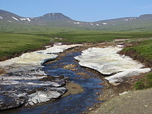 Aufeis in arctic river landscape.JPG