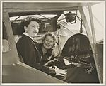 Australian Women Pilots' Association Air Reliability Trial entrants Meg Cornwell (left) and Margaret Sincotts in the cockpit of an Auster J-4 Archer monoplane on the tarmac at an airfield, 1953 (16289750475).jpg
