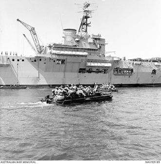 Cross border attacks in Sabah - Australian soldiers being ferried in a small craft, from troop transport HMAS Sydney on its arrival in North Borneo (Sabah) to counter Indonesian confrontation and possible attacks by Filipino pirates as part of their defence aid program to Malaysia in 1964.