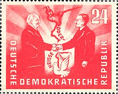 "1951 East German stamp commemorating the Treaty of Zgorzelec establishing the Oder-Neisse line as a ""border of peace"", featuring the presidents Wilhelm Pieck (GDR) and Bolesław Bierut (Poland)"
