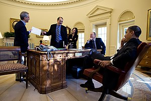 President Barack Obama shares a laugh with, fr...