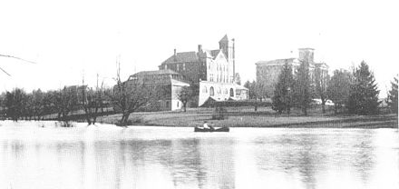 The early campus: Barker Hall in the center, the Main Building to the right, and a lake in the foreground where the Student Center was later built. Barker Hall.jpg