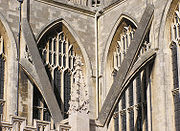 Close-up of two flying buttresses at Bath Abbey, Bath, England. These are the right hand two buttresses of the picture above