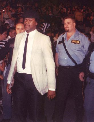 Big Boss Man (wrestler) - Boss Man became a fan favorite after he refused to do the bidding of his villainous manager Slick (left)