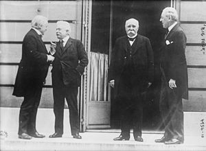 History of suits - At the Treaty of Versailles signing in 1919, the heads of state wore morning dress and lounge suits for informal meetings (as seen here), but frock coats for formal daytime meetings.