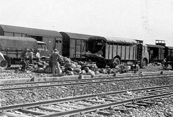 Birkenau Loading personal possessions on trucks standing next to the platform.jpg