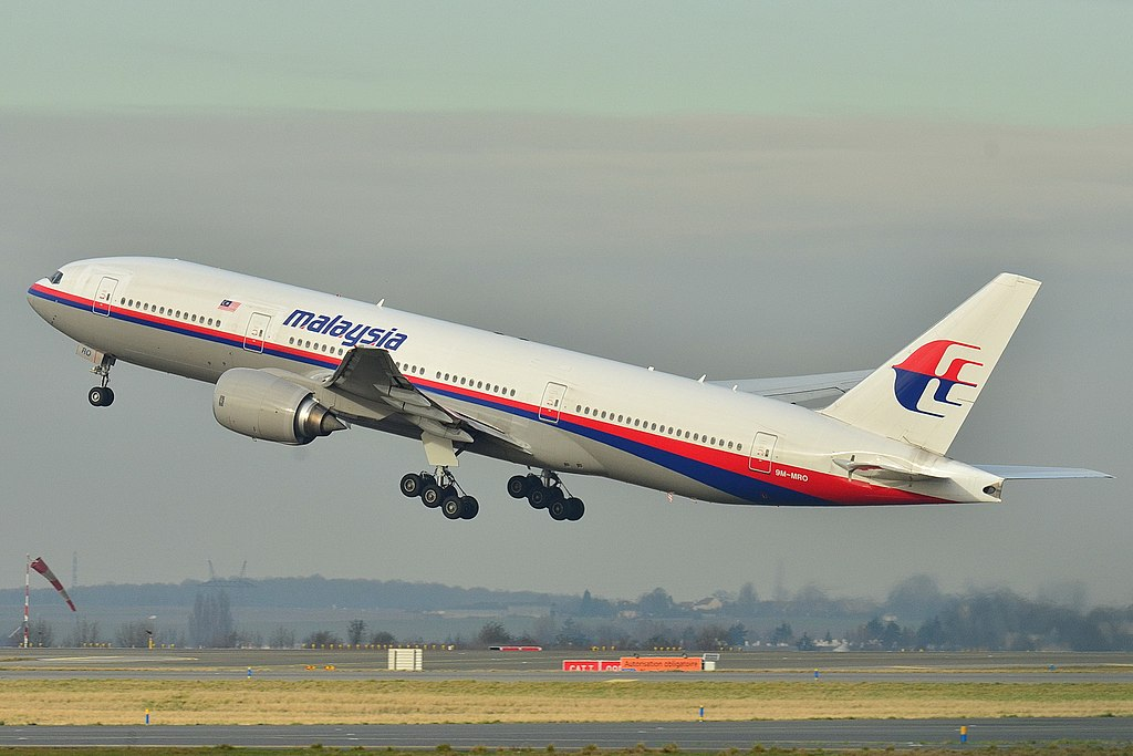 A Boeing 777 in Malaysia Airlines livery just after lifting off the runway