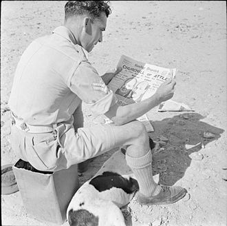 Sunday Dispatch - Corporal E. Hopwood of Acton, Wrexham, studies the Sunday Dispatch before voting in Egypt in the United Kingdom general election of 1945