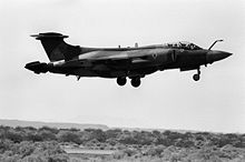 Black and white photograph of a Buccaneer aeroplane flying low.