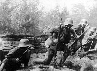 Infiltration tactics - German ''Stoßtruppen'' ('stormtroopers') rising from trenches to attack, equipped with satchel-bags of grenades