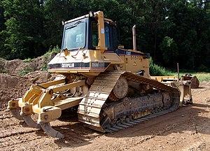 Caterpillar D6 - Caterpillar D6M with a multi-shank ripper.