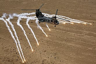 Countermeasure - A CH-46 Sea Knight helicopter launches countermeasures (flares and chaff)