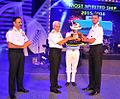 Captain KM Ramakrishnan, Commanding Officer INS Betwa receiving the 'Most Spirited Ship' trophy.jpg