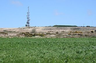 Media in Cornwall - The telecommunications mast on Carnmenellis hill; the mound to the right is a covered reservoir according to the OS map