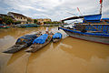 Channels of Hoi An Ancient Town with traditional wooden fishing vessels.jpg