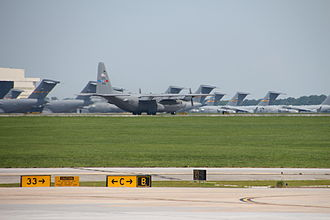 Charleston Air Force Base - C-130 on taxiway with C-17's parked in the background at Charleston Air Force Base (2014)