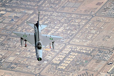A Pakistani F-7 conducts a training mission during a multinational exercise, Dec. 9, 2009, in Southwest Asia