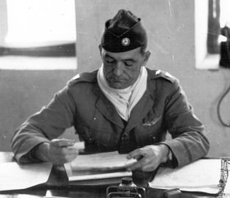 Flying Tigers - Chennault in his Kunming office, May 1942. He wears a US Army brigadier general's star on his left shoulder but Chinese insignia otherwise.