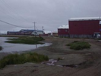 Chevak, Alaska - The school (blue), lake, and condemned old school (red).
