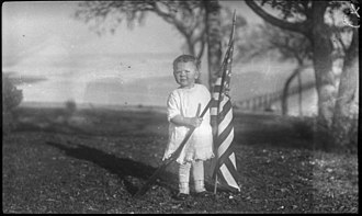 Cultural identity - Child with flag and a gun
