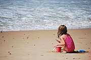 Child playing in the sand at Misquamicut Beach.JPG