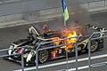 Christophe Bouchut escaping from burning Lotus 2014 WEC Fuji.jpg