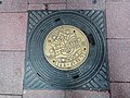 Coat of arms of Ramat Gan on sewage cover.jpg