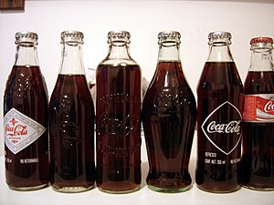 Glass bottle - Various vintage Coca-Cola bottles.