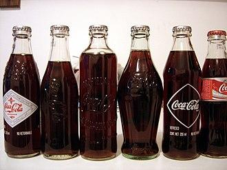 Glass bottle - Various vintage Coca-Cola bottles.