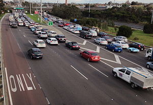 East West Link (Melbourne) - Traffic approaches the city end of the Eastern Freeway, Melbourne, where the East West Link would have begun. Vehicles queue to turn into Hoddle Street (left lanes) or continue west to Alexandra Parade (right lanes).