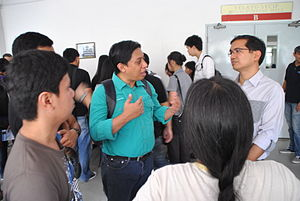 Teodoro Casiño - Teddy Casiño (far right with eyeglasses) listens to members of Wikimedia Philippines and Open Street Map Philippines during a Software Freedom Day event in 2011 at University of Santo Tomas.