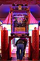 Crawling beneath the divine palanquin at the Chiayi Lantern Festival (Taiwan).jpg