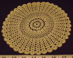 The outer half of this doily was done in a fan stitch.