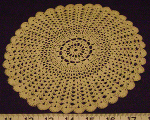 Shell stitch - The outer half of this doily was done in a fan stitch.