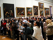 Crowd in front of Mona Lisa at the Louvre. Visitors generally spend about 15 seconds viewing the Mona Lisa.