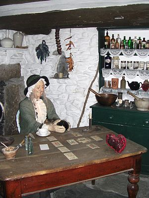 Cunning folk - A model of a 19th-century cunning woman in her house, at the Museum of Witchcraft, Boscastle in England.