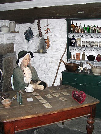 Cunning folk in Britain - A model of a nineteenth-century cunning woman in her house, at the Museum of Witchcraft, Boscastle in England.