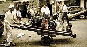 A dabbawala (literally, one who carries a box)...