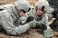 Defense.gov News Photo 100929-A-1260Z-024 - U.S. Army soldiers assigned to the 18th Combat Sustainment Support Battalion set up an M18A1 claymore anti-personnel mine during live-fire training.jpg