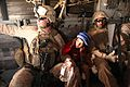 Defense.gov News Photo 110802-M-LQ868-012 - U.S. Marine Corps Staff Sgt. Jeff Liddic left and Lance Cpl. Thelonious Riddick escort Hayatullah a 7-year-old Afghan boy back to his village on.jpg