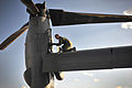 Defense.gov News Photo 120705-F-YG475-917 - U. S. Air Force Staff Sgt. Casey Spang inspects one of the tilt-rotors on a CV-22 Osprey prior to takeoff from the flight line at Cannon Air Force.jpg