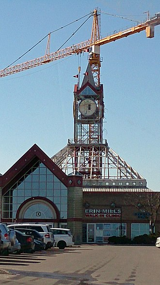 Erin Mills Town Centre - The clock tower being dismantled, which is now a 3D glass sphere, all in the centre court.
