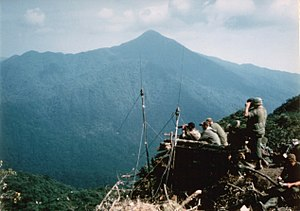 Operation Delaware - LRRPs on Signal Hill scanning for enemy vehicles in the A Sầu Valley below.