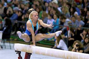 Dorina Böczögő - Böczögő performing her one arm press hold during her balance beam mount, 2013.