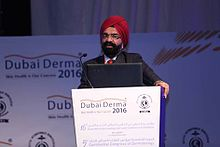 Dr AJ Kanwar speaking at Dubai Derma 2016.jpg
