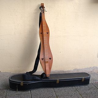 fretted string instrument of the zither family