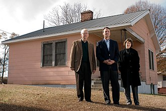 John Edwards - Edwards and his parents stand in front of his childhood home