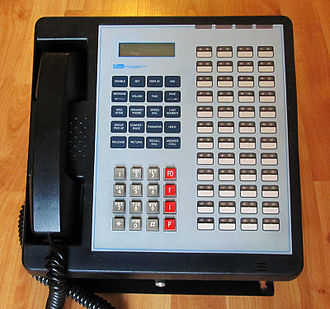Defense Red Switch Network - A Multi Line Phone (MLP-1A), made by Electrospace Systems, which was part of the Defense Red Switch Network since 1983. The phone has the four extra MLPP buttons and 48 programmable buttons for access to both secure and nonsecure lines.