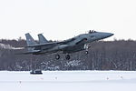 F-15J (890) of 304 Sqn takes off from Chitose Air Base, -21 Feb. 2013 a.jpg